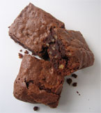 Gluten free spiced Brownies, made with organic, gluten-free ingredients: Fairtrade dark chocolate, butter, walnuts and flavoured with fresh orange zest and ground cardamom seeds