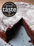 Award-winning flour-free chocolate and prune truffle cake, made with organic, gluten-free and dairy-free ingredients, and Appleton rum