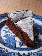Chocolate & Prune Truffle Cake, made with gluten-free, dairy-free ingredients. Dusted with organic unrefined cane icing sugar
