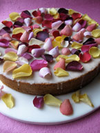 One gorgeous gluten free wedding cake: Rose & Pistachio, topped with lemon glacé icing and sprinkled with fragrant edible rose petals. All ingredients gluten-free, perfect for your glutenfree wedding