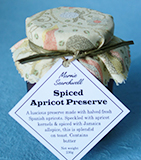 Spiced Apricot Preserve, made with Spanish apricots and organic sugar. With apricot kernels and Jamaica allspice. Finished with a fabulous fabric topper tied with paper ribbon