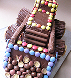 Digger cake made with gluten-free ingredients. Decorated with chocolate beans and biscuits (NB: decorations are not gluten-free). Delivery in London