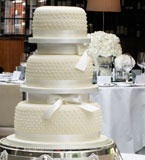 3 tier wedding cake made with gluten free and wheat free organic ingredients. Topped with marzipan and smooth ivory icing