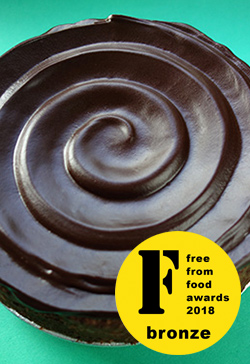 Glutenfree, sugarfree, dairyfree, flourfree Chocolate & Almond Cake, awarded a bronze medal at the FreeFrom Food Awards 2018. Diabetic-friendly chocolate cake, topped with sugarfree dark chocolate ganache.