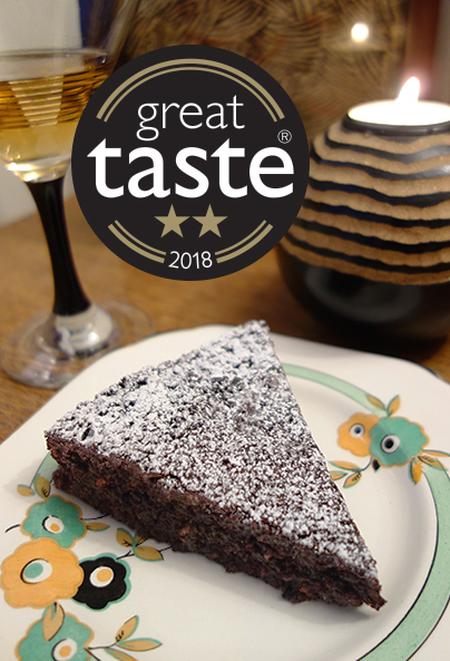 Awarded 2 stars at this year's Great Taste awards, this deliciously damp gluten free, dairy free chocolate cake is made with organic ingredients, including Fairtrade cocoa powder, extra-virgin olive oil, ground almonds and Madagascar vanilla. Keeps well and improves with age. All ingredients gluten-free and dairy-free