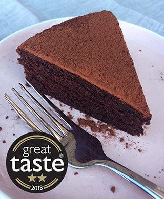 This deliciously damp gluten free, dairy free chocolate cake was awarded 2 stars at the Great Taste awards. Made with organic ingredients, including Fairtrade cocoa powder, extra-virgin olive oil, ground almonds and Madagascar vanilla, it keeps well and improves with age. All ingredients gluten-free and dairy-free
