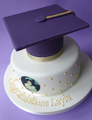 A gluten-free graduation cake, made with chocolate & almonds and covered with ganache and icing. All made with glutenfree ingredients, and delivered in London