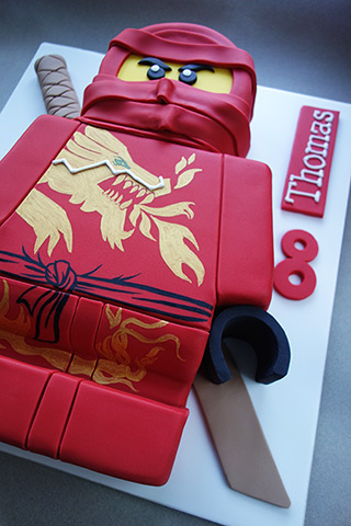 Gluten-free Ninjago Cake: gluten free chocolate cake filled with organic  buttercream and covered with organic marzipan and sugarpaste icing. With handpainted golden dragon motif. All ingredients glutenfree