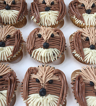 Gluten-free birthday cupcakes, made with organic ingredients. These puppy cups are egg-free too, decorated with piped chocolate & vanilla buttercream. Delivery available in London. All ingredients gluten free