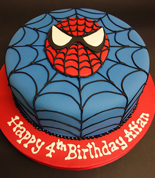 Gluten-free, dairy-free Spiderman Chocolate Cake. Filled with dairy-free white chocolate buttercream & covered with sugarpaste icing