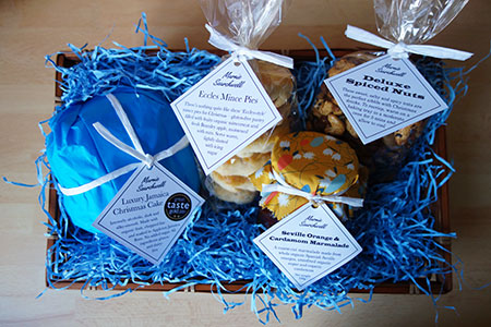 Christmas Hamper: 4-inch gluten free, dairy free Luxury Jamaica Xmas Cake, Pack of 6 gluten free Mince Pies (not available this year), 250g Spiced Mixed Nuts, Jar of Seville Orange & Cardamom Marmalade. All ingredients gluten free & dairy free
