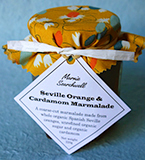 Lemon & Vanilla Jam: Made with hand-cut organic Spanish Seville oranges, organic sugar and blackstrap molasses, and spiced with crushed cardamom seeds and pods. Finished with a fabulous fabric topper tied with paper ribbon