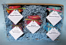 5-jar boxed set of preserves includes Spiced Boozy Prunes, Vintage Seville Orange Marmalade, Apple Butter, Beetroot Relish and either Chilli Chutney or Garden Apple Chutney