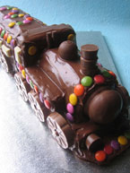 Chocolate Train Cake Made With Organic Gluten Free Sponge And Decorated Beans